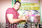 Aideen O'Sullivan in the Sam Maguire in Top of Coom last Thursday night with Kerry footballer, Aidan O'Mahony.