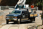 Ford Crew cab with flat bed and racks at job site with foundation forms