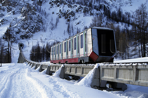 December 1996: A funicular rail car moving up the mountain at Val d'Isere, France. Photo: Neale Haynes/actionplus..9012 winter sports snow snowy mountain alp french ski railway train tram track rail