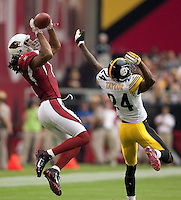 10/23/11 Glendale, AZ:  Arizona Cardinals wide receiver larry Fitzgerald #11 catches a ball over Pittsburgh Steelers CB Ike Taylor #24 for a first down during the second quarter of an NFL game played at University of Phoenix Stadium between the Arizona Cardinals and the Pittsburgh Steelers. The Steelers defeated the Cardinals 32-20.