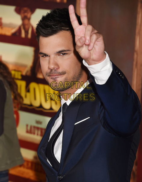 UNIVERSAL CITY, CA - NOVEMBER 30: Actor Taylor Lautner arrives at the premiere of Netflix's 'The Ridiculous 6' at AMC Universal City Walk on November 30, 2015 in Universal City, California.<br /> CAP/ROT/TM<br /> &copy;TM/ROT/Capital Pictures