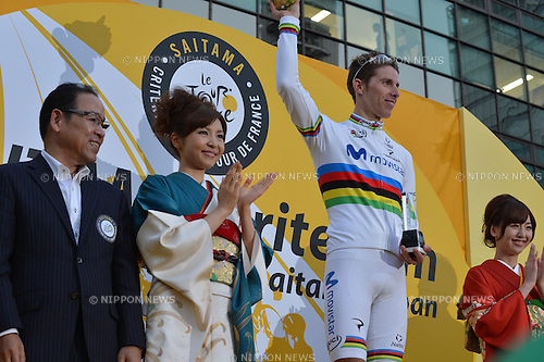 Rui Costa takes the best climber prize at Saitama Criterium by Le Tour de France, Saitama, Japan, Saturday 26th October, 2013. <br /> The first ever overseas race organised by Le Tour de France was held in Saitama, Japan. Despite fears of a typhoon the route was packed with spectators trying to get a glimpse of their heroes. They were rewarded with a thrilling final 20 lap race in which Chris Froome, Peter Sagan and Rui Costa broke free with two laps to go. Froome escaped on the last lap and Sagan beat Costa in a sprint for second. The whole event was came with all the trappings of Le Tour with the traditional red race car leading the pack.