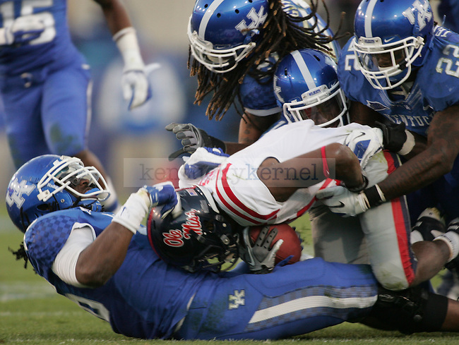 Mississippi Rebels running back Jeff Scott  gets tackled by a group of Kentucky defenders during the second half of the UK's home game against Ole Miss at Commonwealth in Lexington, Ky., Nov. 5, 2011. Photo by Brandon Goodwin | Staff