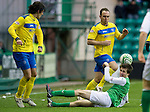 Hibs v St Johnstone...21.01.12.Callum Booth is knocked to the ground after colliding with Lee Croft.Picture by Graeme Hart..Copyright Perthshire Picture Agency.Tel: 01738 623350  Mobile: 07990 594431