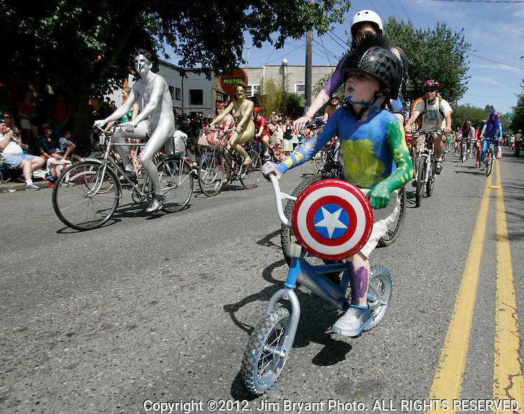 One youngster attended painted nude bicyclists  parade dress as Captain America during the 25th  Annual Fremont Summer Solstice Parade in Seattle on June 22, 2013.     UPI Photo/Jim BryantPainted nude bicyclists  ride during the 25th  Annual Fremont Summer Solstice Parade in Seattle on June 22, 2013.     ©2013.  Jim Bryant.  ALL RIGHTS RESERVED.