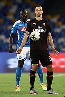 12th July 2020; Stadio San Paolo, Naples, Campania, Italy; Serie A Football, Napoli versus AC Milan; Zlatan Ibrahimovic of AC Milan holds off Kalidou Koulibaly of Napoli
