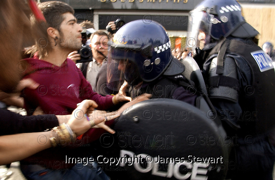 04/07/2005         Copyright Pic : James Stewart.File Name : jspa09 g8 edinburgh mon.POLICE CLASH WITH PROTESTORS IN PRINCESS STREET ....Payments to :.James Stewart Photo Agency 19 Carronlea Drive, Falkirk. FK2 8DN      Vat Reg No. 607 6932 25.Office     : +44 (0)1324 570906     .Mobile   : +44 (0)7721 416997.Fax         : +44 (0)1324 570906.E-mail  :  jim@jspa.co.uk.If you require further information then contact Jim Stewart on any of the numbers above.........