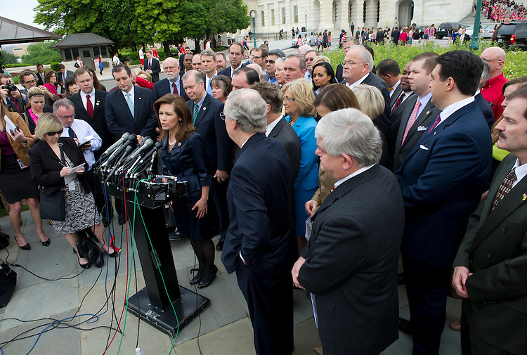 UNITED STATES - May 16: Rep. Michele Bachmann, R-MN., Sen. Mitch McConnell, R-KY., and other Tea Party leaders during a press conference on the IRS. (Photo By Douglas Graham/CQ Roll Call)