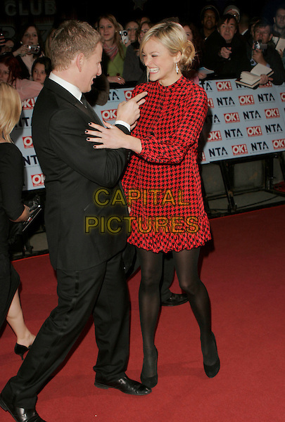 PATRICK KEILTY & FEARNE COTTON.Arrivals at the 12th Annual National Television Awards 2006, held at the Royal Albert Hall, London, England, October 31st 2006..full length paddy red and black houndstooth dogtooth sixties style print patterned dress funny hand pointing gesture .CAP/AH.©Adam Houghton/Capital Pictures.