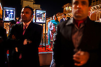 Guests stand around a a jewelry exhibition while listening to a speech before a violin recital at the OzFest Gala Dinner in the Jaipur City Palace, in Rajasthan, India on 10 January 2013. Photo by Suzanne Lee