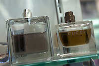 Bottles of Euphoria and Gucci perfume for men are seen on a shelf at a Jean Coutu Pharmacy in Quebec city March 4, 2009.