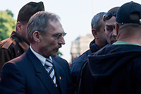 Sandor Pinter (2nd L) minister of internal affiars surrounded by bodyguards attends an anti-government rally of firemen and other law enforcement workers who protest in front of the Parliament against the government's austerity measures in Budapest, Hungary on May 06, 2011..The government has launched a package of fiscal reforms to cut the budget deficit, including scrapping early retirement, which mostly affects law enforcement personnel. ATTILA VOLGYI