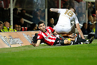 Neal Maupay of Brentford is sat on by Pontus Jansson of Leeds United during the Sky Bet Championship match between Brentford and Leeds United at Griffin Park, London, England on 4 November 2017. Photo by Carlton Myrie.