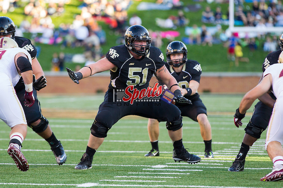 Cory Helms (51) of the Wake Forest Demon Deacons on offense during second half action against the Boston College Eagles at BB&T Field on October 25, 2014 in Winston-Salem, North Carolina.  The Eagles defeated the Demon Deacons 23-17.  (Brian Westerholt/Sports On Film)