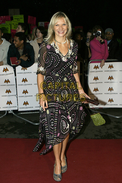 JO WHILEY.MOBO Awards 2004 - Arrivals, Royal Albert Hall.September 30th, 2004.full length, black printed, pattern dress, platform shoes.www.capitalpictures.com.sales@capitalpictures.com.© Capital Pictures.