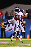 Canton, Ohio - August 1, 2019: Denver Broncos cornerback Trey Johnson #39 and cornerback Linden Stephens #37 celebrate Johnson's interception during a pre-season game against the Atlanta Falcons at the Tom Benson Hall of Fame stadium in Canton, Ohio August 1, 2019. This game marks start of the 100th season of the NFL. (Photo by Don Baxter/Media Images International)