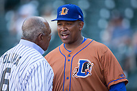 Durham Bulls hitting coach Ozzie Timmons (44) chats with former Minnesota Twins great Tony Oliva prior to the game against the Charlotte Knights at BB&T BallPark on May 16, 2017 in Charlotte, North Carolina.  The Knights defeated the Bulls 5-3. (Brian Westerholt/Four Seam Images)