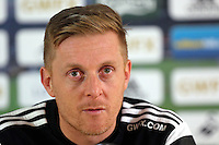Pictured:  Garry Monk, manager for Swansea, talks to the media during the Swansea City Press Conference on Thursday January 15, 2015 in Swansea, Wales.