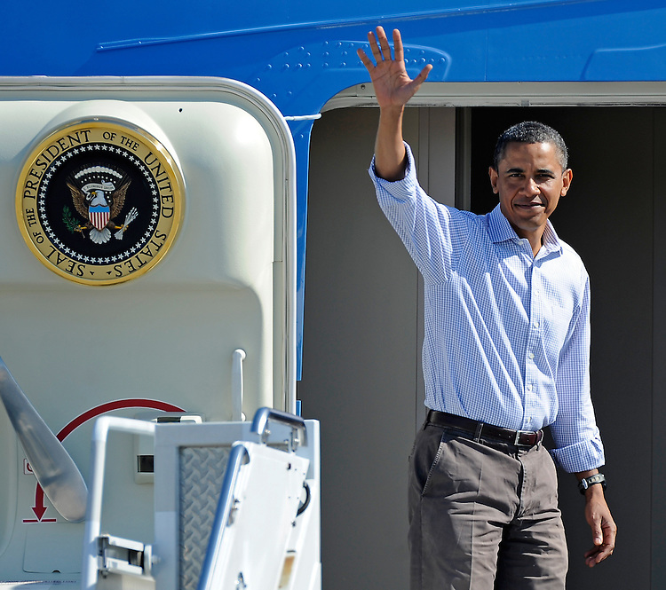 (082910, Bourne, MA) President Barack Obama waves as he boards Air Force One at the Cape Cod Coast Guard Air Station in Bourne Sunday, August 29, 2010. Photo by Christopher Evans