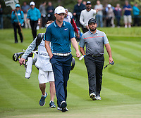 22.05.2015. Wentworth, England. BMW PGA Golf Championship. Round 2. Francesco Molinari [ITA] and Ross Fisher [ENG] walk on to the 18th Green.