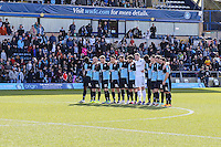 Wycombe Wanderers players and fans observe a minute's silence in memory of the victims of the Brussels attack earlier in the week ahead of the Sky Bet League 2 match between Wycombe Wanderers and Mansfield Town at Adams Park, High Wycombe, England on 25 March 2016. Photo by David Horn.