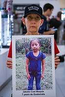 NEW YORK, USA - September 12 : A protester its seen holding a migrant children picture during a silent protest on September 12, 2019 in New York, USA.<br /> Demonstrators joinedfor a silent protest againist ICE, child immigrant detention, and torture of asylum seekers at the Oculus in New York City. <br /> (Photo by Luis Boza/VIEWpress/Corbis via Getty Images).