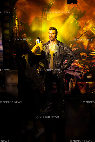 A visitor takes a pictures of a wax figure of Arnold Schwarzenegger, actor and politician on display at the Madame Tussauds Tokyo wax museum in Odaiba, Tokyo, June 15, 2015. The world famous British wax museum ''Madame Tussauds'' opened its 14th permanent branch in Tokyo in 2013 and exhibits international and local celebrities, sports players and politicians. New additions to the collection include wax figures of the Japanese figure skater Yuzuru Hanyu and the actor Benedict Cumberbatch. The wax figure of Benedict Cumberbatch will be exhibited until June 30th. (Photo by Rodrigo Reyes Marin/AFLO)