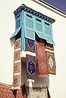 "Tunisia, Sidi Bou Said.  Rugs Airing in an Enclosed ""Harem Window."""