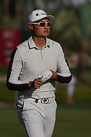 Haotong Li (CHN) on the 16th fairway during Round 3 of the Abu Dhabi HSBC Championship at the Abu Dhabi Golf Club, Abu Dhabi, United Arab Emirates. 18/01/2020<br /> Picture: Golffile | Thos Caffrey<br /> <br /> <br /> All photo usage must carry mandatory copyright credit (© Golffile | Thos Caffrey)