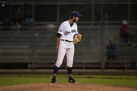 Helena Brewers relief pitcher Tyler Tungate (22) looks in for the sign during a Pioneer League game against the Orem Owlz at Kindrick Legion Field on August 21, 2018 in Helena, Montana. The Orem Owlz defeated the Helena Brewers by a score of 6-0. (Zachary Lucy/Four Seam Images)