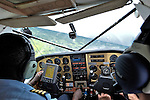 Flying over the Congo with Jacques Umembudi Akasa, a United Methodist missionary pilot for Wings of Caring Aviation, a program of the United Methodist Church in the Democratic Republic of the Congo. Copilot is Steve Quigg, a United Methodist missionary assigned to Mission Safety International.