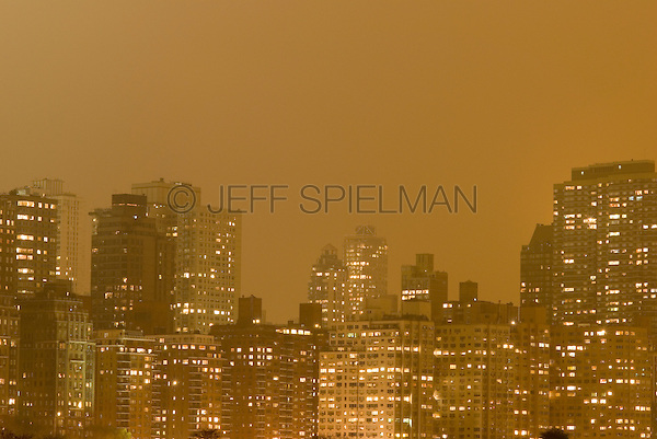 AVAILABLE FROM JEFF AS A FINE ART PRINT.<br /> <br /> AVAILABLE FROM PLAINPICTURE FOR COMMERCIAL AND EDITORIAL LICENSING.  Please go to www.plainpicture.com and search for image # p5690082.<br /> <br /> Illuminated Skyline of Manhattan's Upper East Side on an Overcast Night, New York, New York, USA