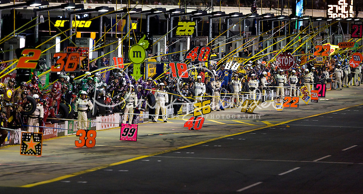 Pit crews wait during the Bank of America 500 NASCAR race at Lowes's Motor Speedway in Concord, NC.