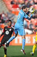 Andy Gruenebaum(30) of the Columbus Crew goes up to make a save. The Columbus Crew defeated D.C. United 2-1 ,at RFK Stadium, Saturday March 23,2013.
