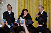 Roxane Giron flanked by  United States President Barack Obama (L) and Vice President Joe Biden  speaks at a reception for Hispanic Heritage Month in the East Room of the White House on October 12, 2016 in Washington, DC. <br /> Credit: Olivier Douliery / Pool via CNP