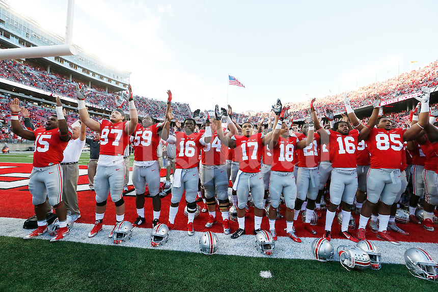 Players sing Carmen Ohio at the end of an NCAA football game between the Ohio State Buckeyes and the University of Hawaii at Ohio Stadium in Columbus, Ohio, on Saturday, September 12, 2015. (Columbus Dispatch photo by Fred Squillante)