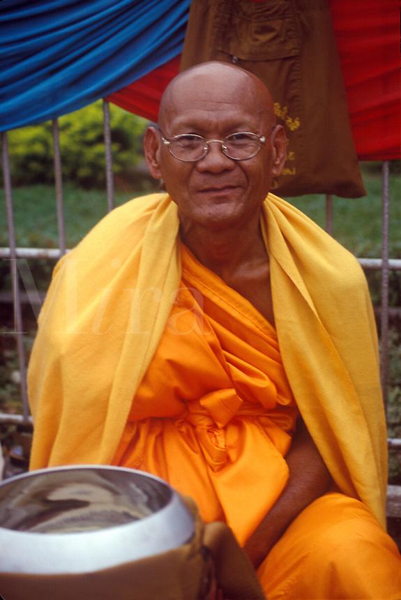 Buddhist Monk with Money Bowl