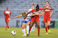 Boyds MD - April 19, 2014: Merritt Mathias (9) of FC Kansas City goes against Robyn Gayle (5) of the Washington Spirit. The Washington Spirit defeated the FC Kansas City 3-1 during a regular game of the 2014 season of the National Women's Soccer League at the Maryland SoccerPlex.