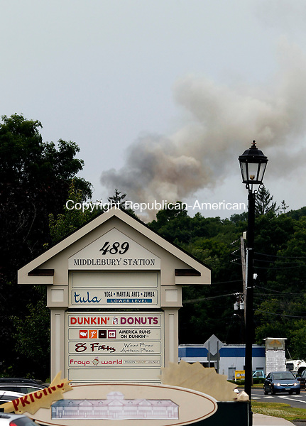Middlebury, CT- 03 July 2014-070314CM08-  Smoke can be seen from Middlebury Station from a house fire at 725 Breakneck Hill Rd in Middlebury on Thursday.  Firefighters from Middlebury, Southbury, Watertown and Waterbury responded to fight the blaze.   Christopher Massa Republican-American