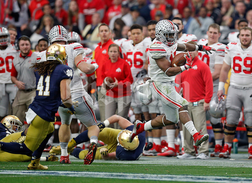 Ohio State Buckeyes running back Ezekiel Elliott (15) heads up the sideline against Notre Dame Fighting Irish in the second quarter during the Fiesta Bowl in the University of Phoenix Stadium on January 1, 2016.  (Dispatch photo by Kyle Robertson)