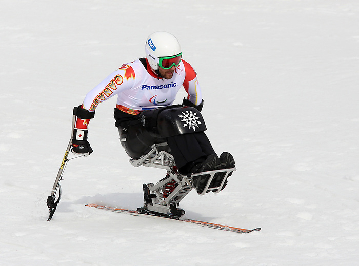 Sochi, Russia.08/03/2014. Canadian Kurt Oatway competes in the mens sitting skiing downhill in Sochi, Russia during the 2014 Paralympic Winter Games.(Photo:Scott Grant/Canadian Paralympic Committee)