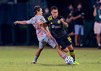 16th July 2020, Orlando, Florida, USA;  New York Red Bulls midfielder Florian Valot (22) defends the run of Columbus Crew midfielder Lucas Zelarrayan (10) during the MLS Is Back Tournament between the Columbus Crew SC versus New York Red Bulls on July 16, 2020 at the ESPN Wide World of Sports, Orlando FL.