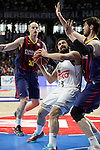 Real Madrid´s Sergio Llull and Barcelona´s Lampe and Tomic during Liga Endesa Final first match at Palacio de los Deportes in Madrid, Spain. June 19, 2015. (ALTERPHOTOS/Victor Blanco)