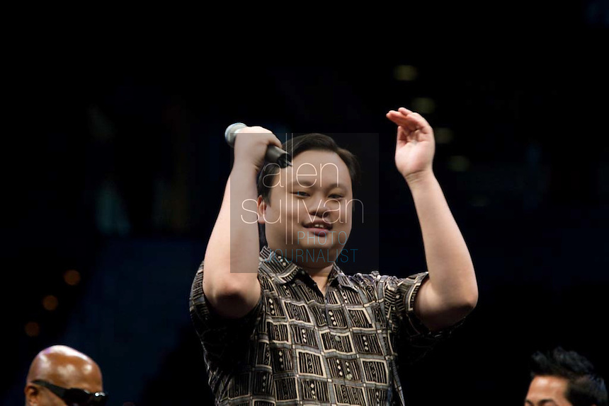"""Former """"American Idol"""" contestant William Hung sings during a Dreams N2 Reality show and casting call at Philips Arena in Atlanta on Saturday, August 4, 2007. People offered their auditions in hopes of gaining spots on game shows and others in the reality TV genre."""