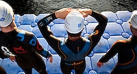 30 JUN 2011 - LONDON, GBR - Competitors wait on the pontoon for the start of the second men's supersprint elimination wave at the GE Canary Wharf Triathlon (PHOTO (C) NIGEL FARROW)