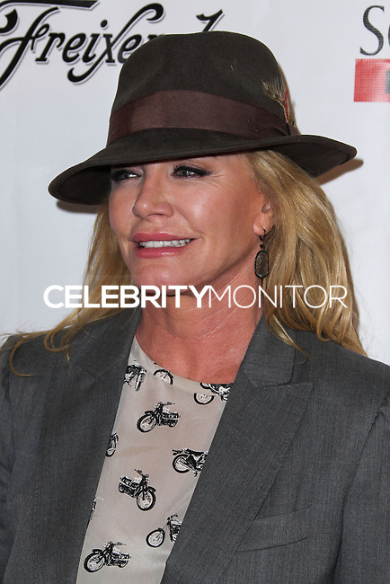 "HOLLYWOOD, LOS ANGELES, CA, USA - APRIL 01: Shannon Tweed at the Los Angeles Premiere Of Screen Media Films' ""10 Rules For Sleeping Around"" held at the Egyptian Theatre on April 1, 2014 in Hollywood, Los Angeles, California, United States. (Photo by Xavier Collin/Celebrity Monitor)"