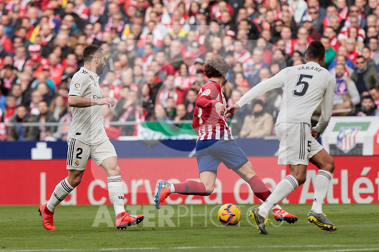 Atletico de Madrid's Antoine Griezmann and Real Madrid's Dani Carvajal (L) and Raphael Varane (R) during La Liga match between Atletico de Madrid and Real Madrid at Wanda Metropolitano Stadium in Madrid, Spain. February 09, 2019. (ALTERPHOTOS/A. Perez Meca)