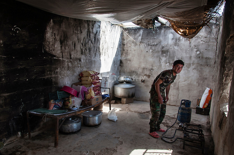 20/07/14  Iraq -- Daquq, Iraq -- A peshmerga in the chicken of the base in Albu Muhamad village of  Daquq.