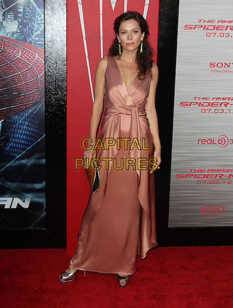 "Anna Friel.Los Angeles Premiere Of ""The Amazing Spider-Man"" Held The at Regency Village Theatre, Westwood, California, USA..June 28th, 2012.full length pink silk satin sleeveless dress gold clutch bag wrap .CAP/ADM/FS.©Faye Sadou/AdMedia/Capital Pictures."