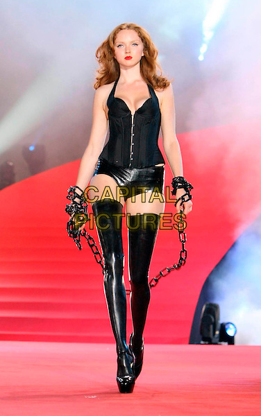 LILY COLE.Agent Provocateur Fashion Show during  the Lifeball 2008 - Show, Rathaus, Vienna, Austria, 17th May 2008..Full length model modelling black leather pvc thigh high boots corset underear lingerie dominatrix pants hotpants chain.CAP/PPG.©Eckharter/People PIcture/Capital.Pictures